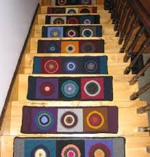 Individual carpets identify the treads.  However, for those who are poorly sighted or live with dementia the would be too much pattern