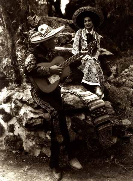 Mexican playing the guitar for his beloved, Mexico, circa 1930. by Cassasola