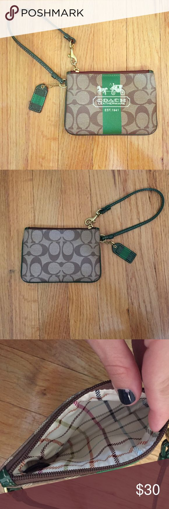 Coach Wristlet This was purchased it from a Coach Outlet Store (Tanger Outlets). It has been used less than a handful of times and is in great condition. Coach Bags Clutches & Wristlets