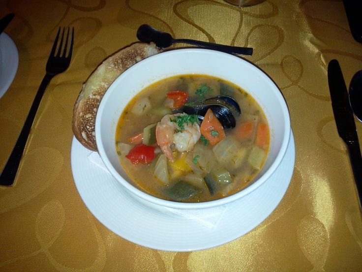Fish Chef Soup with vegetables, seafood and garlic baguette
