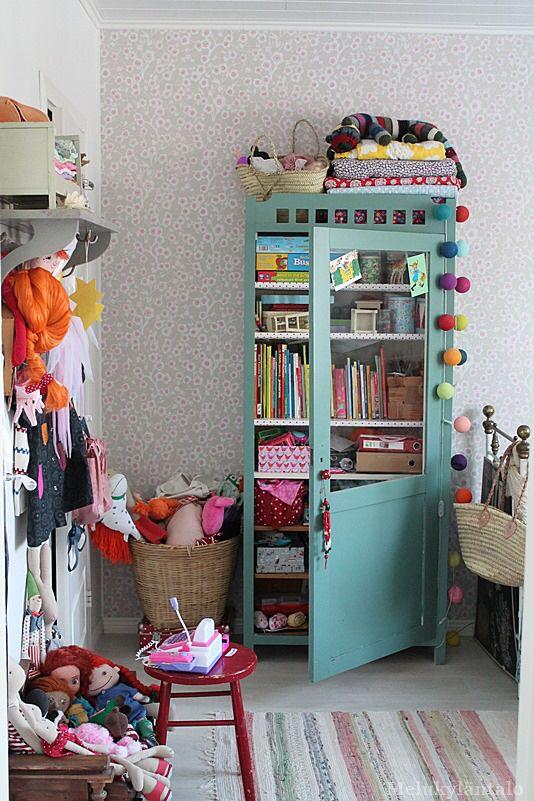 Turquoise cabinet toy storage