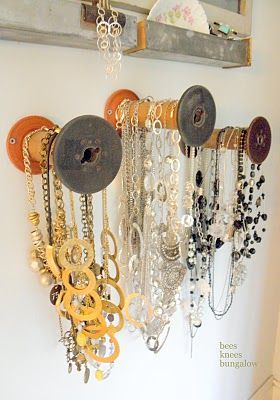 Necklace holders on wall of barn...or scarves