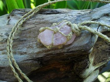 A hemp wrapped raw / rough rose quartz hippie necklace.