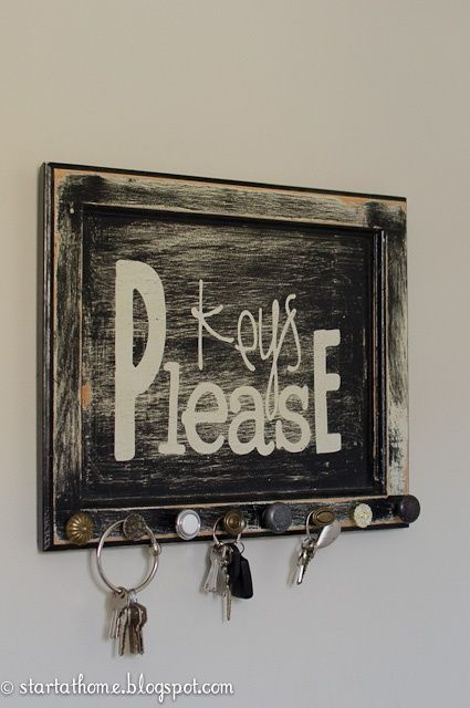 This sign is made out of an old cupboard door with miss match knobs