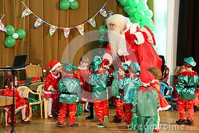 Christmas celebrations at kindergarten - children enjoy the arrival of Santa Claus.