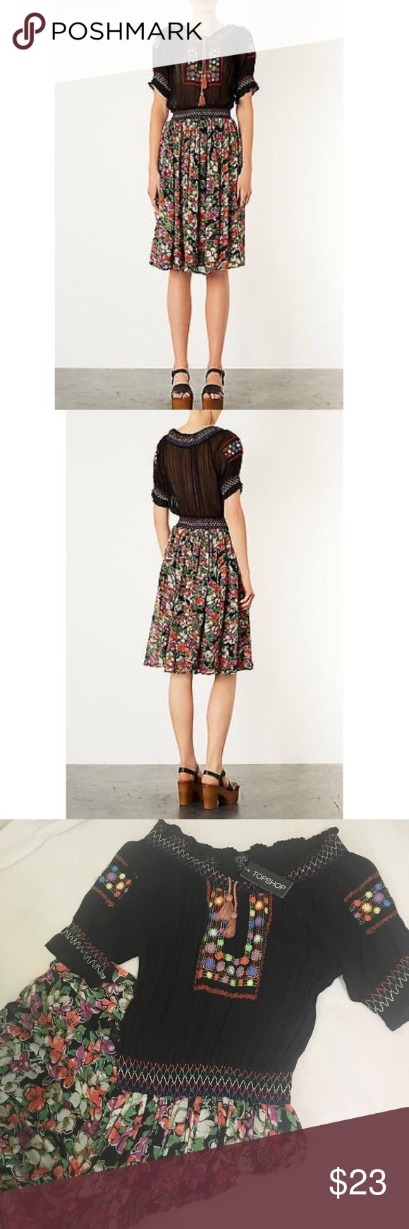 Top Shop Mexican Boho dress NWT. Top Shop woven midi dress! With multi-colour floral print floaty skirt. Gathered at the waist and a black smock top with multi color embroidery and tie tassel. Topshop Dresses Midi