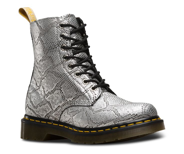 (women's size 7) This vegan version of our classic Pascal 8-eye boot is a wild take on DM's core DNA in a highly textured, metallic silver, faux snakeskin. Tough and durable like the real thing — but contains absolutely zero animal products. 100% vegan product, with a special yellow scripted heel-loop reserved for vegan Dr. Martens products 8-eye boot Retains all the classic Doc's DNA, like yellow welt stitching, grooved edges and a scripted heel-loop Built on the iconic Dr. Martens…