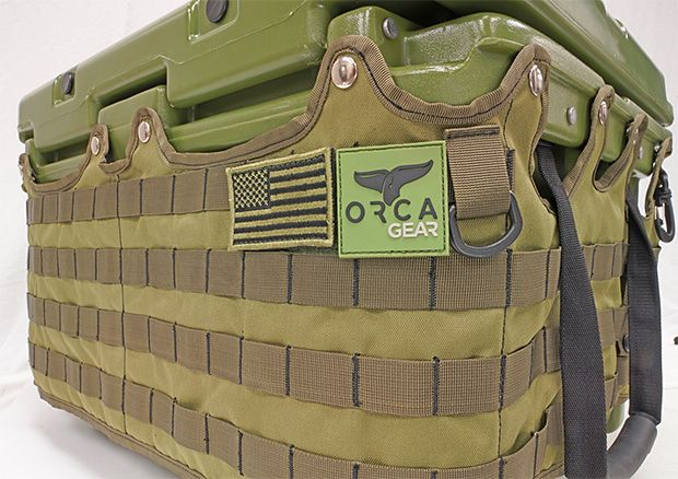Orca Cooler Molle Wrap -- Orca Gear has made their 26-quart cooler even more adventure-friendly by adding a full wrap of military-style MOLLE webbing. The snap on cover is made of tough 600 denier nylon with tactical velcro closures and ABS hardware. $50