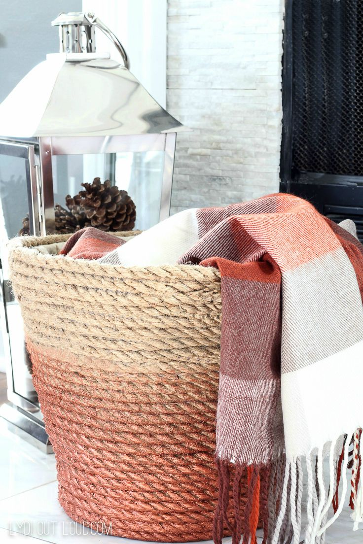 I'm obsessed with this DIY Metallic Rope Basket - so perfect to drape throw blankets in!