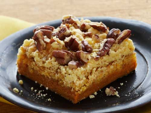 Topped with chopped pecans, these bars made with yellow cake mix and canned pumpkin might become your family's new holiday favorite.