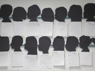 no-no: writing with students' silhouettes-- look great, but wallpaper, not down where kids can read them, becomes inauthentic text