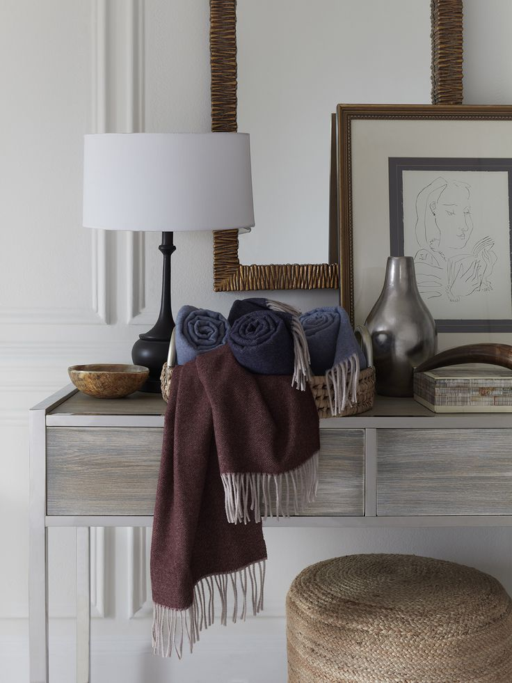 The warmth of one our most loved throws is reimagined as a scarf for a cozy accessory this winter. The Tartini scarf celebrates the richness of the season with shadowy hues woven from pure, Merino wool.
