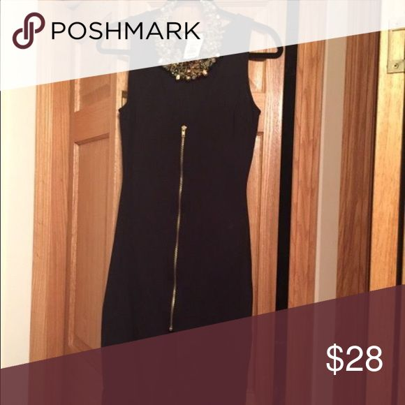 Black Tight fitting Dress Black tight fitting dress with zipper in front. Never used, still has tags.  Size 4 (medium). Knee length Dresses Midi