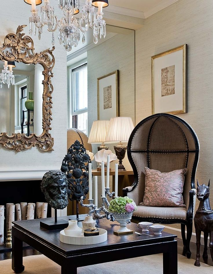 A French Porter's Chair and a Louis XIV style mirror add a Gallic influence to this modern apartment