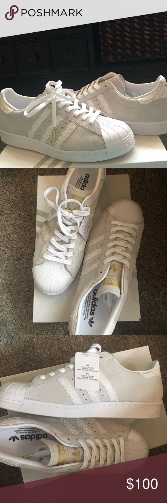 Custom adidas superstar shoes(never worn) Adidas superstars never worn with tags custom designed with grey suede, snake skin stripes and heel pad, white laces with gold tips, gold adidas logo on tongue and heel...extra white laces with adidas bag Adidas Shoes Sneakers