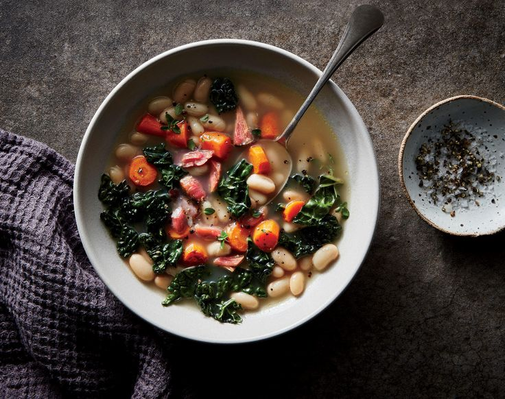 Ham, Kale, and White Bean Soup | The water used to cook a pot of beans is really liquid gold, infused with aromatics and thickened with starch from the beans. It makes perfect sense to give the cooking liquid a second life as the broth for the soup (and save the trouble of rinsing and draining). The ham hock will season the broth and the beans as they cook; you won't need additional salt once they are done. Instead of cooking the kale and carrots in the soup, give them a quick sauté and stir…