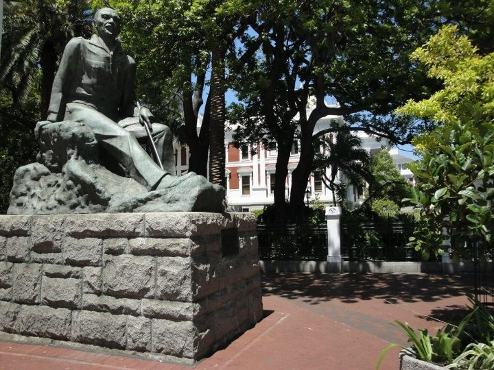 A statue of JC Smuts in front of the Parliament Buildings at the government gardens