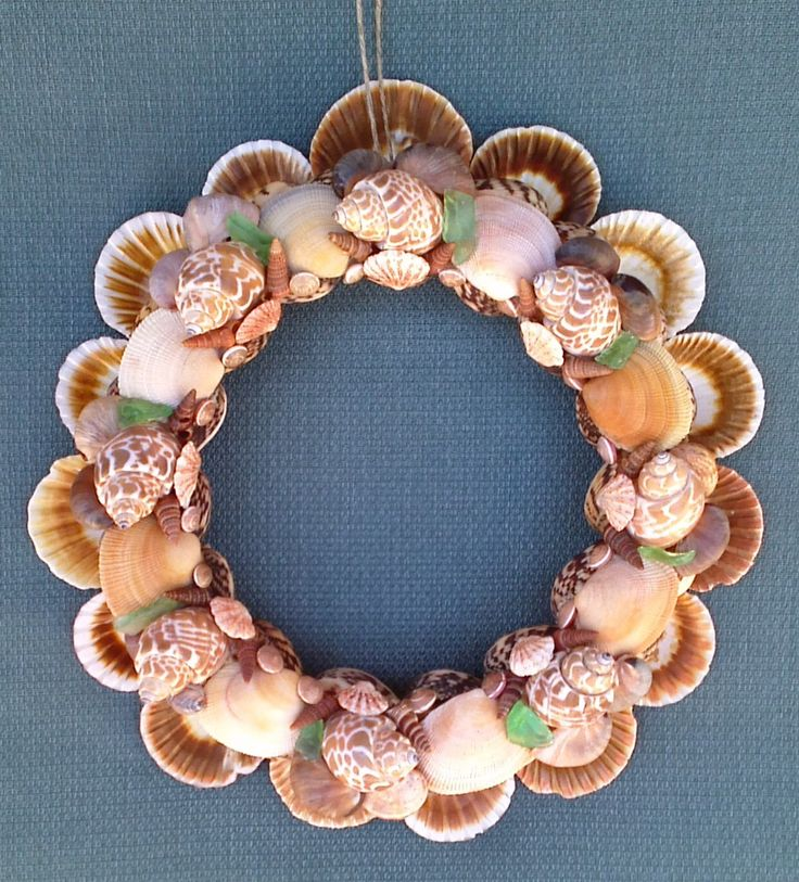 "Seashell Wreath 11 1/2"" sea shell wreath beach decor ocean decor home decor hand made hand crafted seashell art nautical decor seashells by PurpleSurfSeashells on Etsy https://www.etsy.com/listing/195205072/seashell-wreath-11-12-sea-shell-wreath"