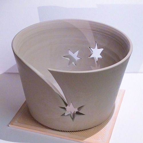 Fleur de lys and shooting star cut out yarn bowls. Unfired white...