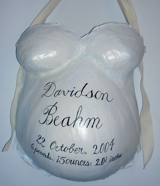 Birth announcement belly cast.