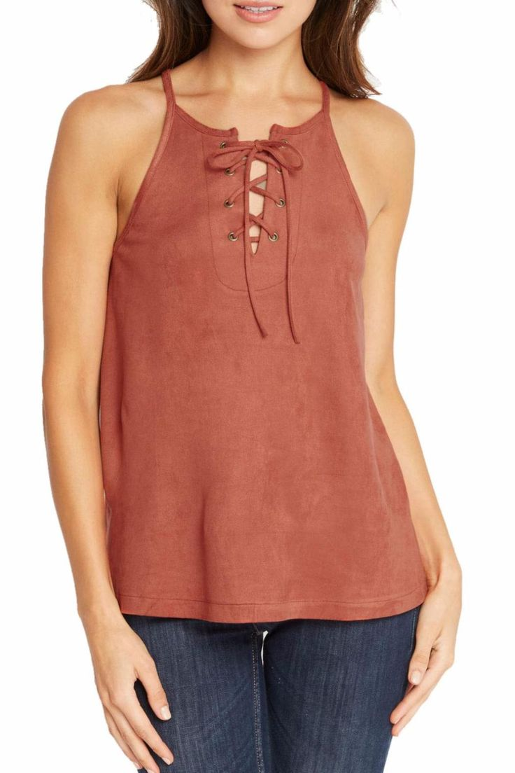 This gorgeous faux suede blouse is a great addition to any closet. It's so soft and it looks and feels like real suede! Lace ups are all the rage right now and in this beautiful Fall color? Yes, please! Pair it with blue jeans for a casual look or white jeans for a dressier look.   Rust Lace Up Top by Soprano. Clothing - Tops - Sleeveless Clothing - Tops - Tees & Tanks Hawaii