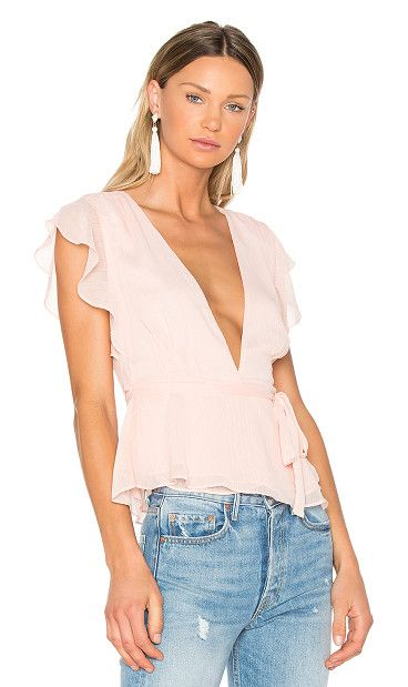 x REVOLVE Butterfly Blouse by Lovers + Friends. Ruffle up your usual charm in the Lovers + Friends Butterfly Top. This dainty wrap top features a surplice neckline f...