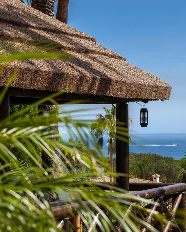 Cape Reed International On Instagram Mediterranean Living In The Costa Del Sol Mediterranean L Thatched Roof Outdoor Costa Del