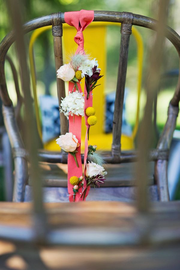 Delightful Flowers Pinned To A Ribbon For Chair Backs // Photo By Keidra LeJeuene //