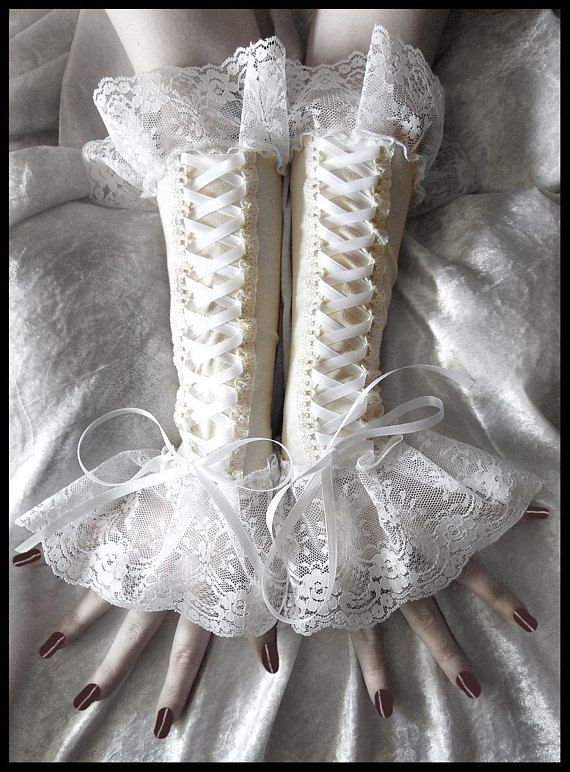 Cities in Dust Gothic Lolita Corset Style Long Arm Warmers in Creamy Ivory with Pure Snow White Lacing Detail and Lace! Perfect for weddings, special occasions, going out or even everyday! The ribbon bow at the end can be shortened to your taste- just let me know in the notes to seller!