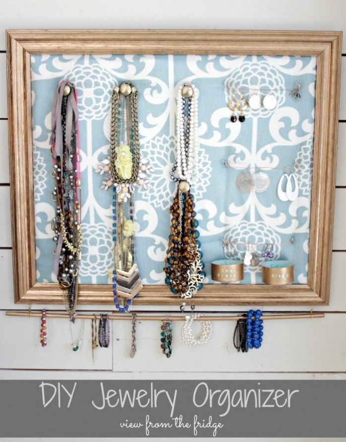 Knobs, pegs, picture frame &  fabric for hanging jewelry. How about framing a map and use over a desk for scissors, hole punch, tape rolls, ribbon rolls, keys, etc.