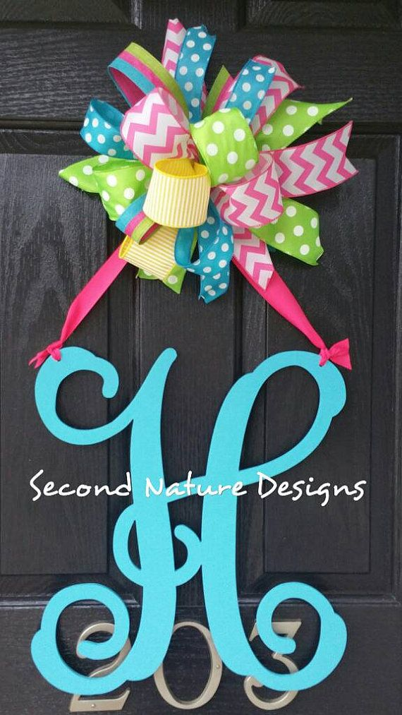 Check out this item in my Etsy shop https://www.etsy.com/listing/223499930/hand-painted-initial-door-hanger-with-a