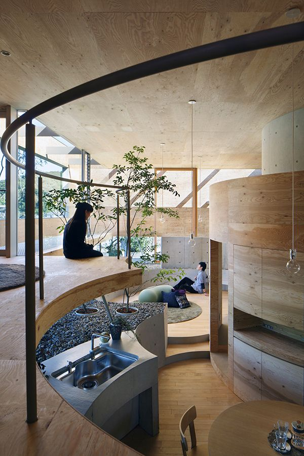 "The multilevel ""Pit House"" employs sensual curves contained within an outer rectangular shell of wood, glass and steel to create zen-like simplicity; Okayama, Japan 