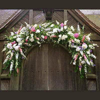 Gorgeous swag for over a church door. Would look just as good over an entrance gate or reception door