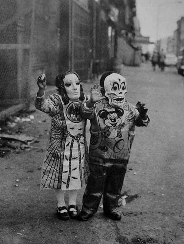 Creepy take on a Mickey Mouse costume by the kid on the right.   19 Deeply Horrifying Vintage Halloween Costumes