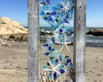 12 X 24 Mostly blues and clear beach glass with white star fish .These panels are vertical . I know you have just the spot for them.Can be sold as a pair.
