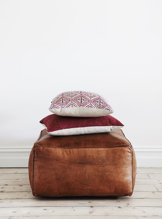 leather pouff and pillows