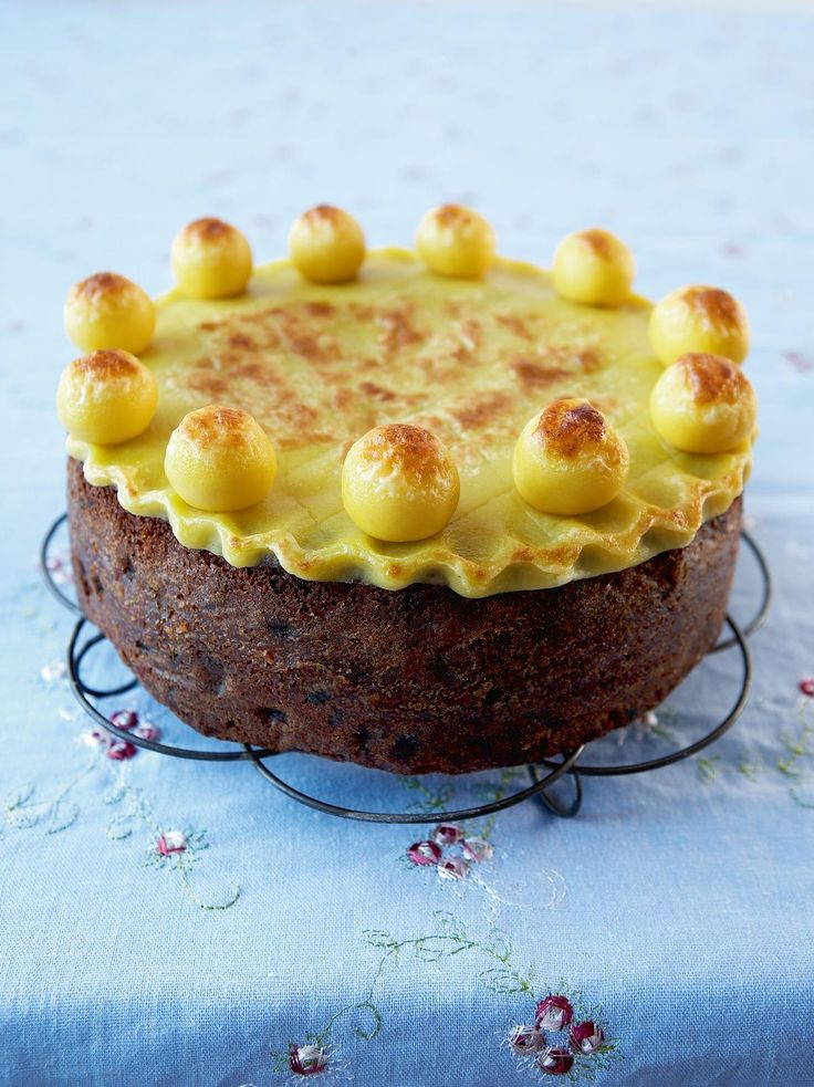 """Easter Simnel Cake ~ """"This has become the traditional Easter cake, but originally it was given by servant girls to their mothers when they went home on Mothering Sunday. The almond-paste balls represent the eleven (true) apostles"""" 