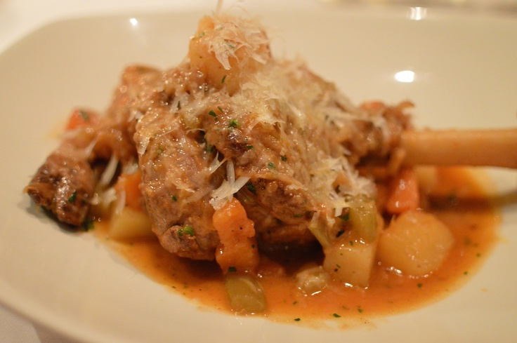 Seven Hills kid goat cooked on the bone in tomato w potatoes & grated Pecorino