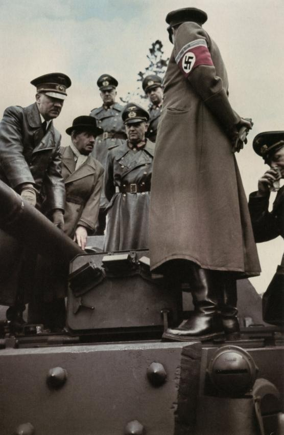 Hitler inspecting a Panzer tank: Adolf Hitler, Ferdinand Porsche, Walter Buhle and Albert Speer inspecting weaponry at March 18 or 19, 1943 in Rügenwalde in Pommern.