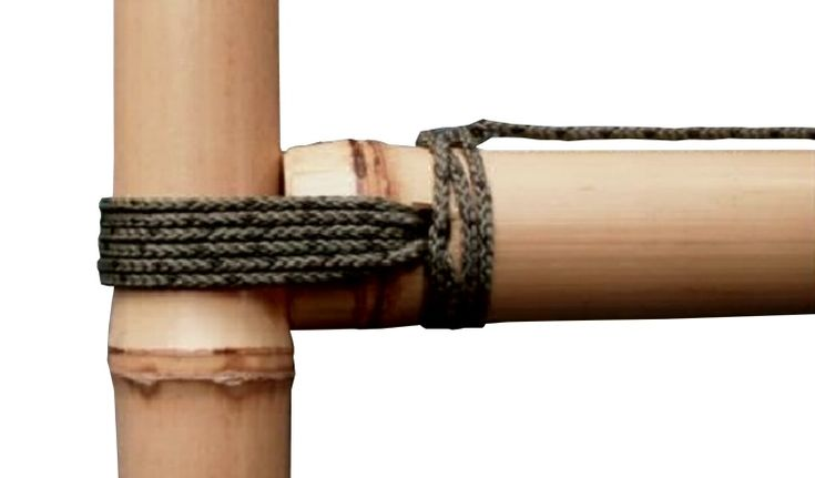 The drilled joint can also be used to connect the end of a cross-pole to an upright, as shown above. For this application, the lashings should be tied above a node on the upright. Downward pressure on the cross-pole will simply tighten the bamboo lashings further
