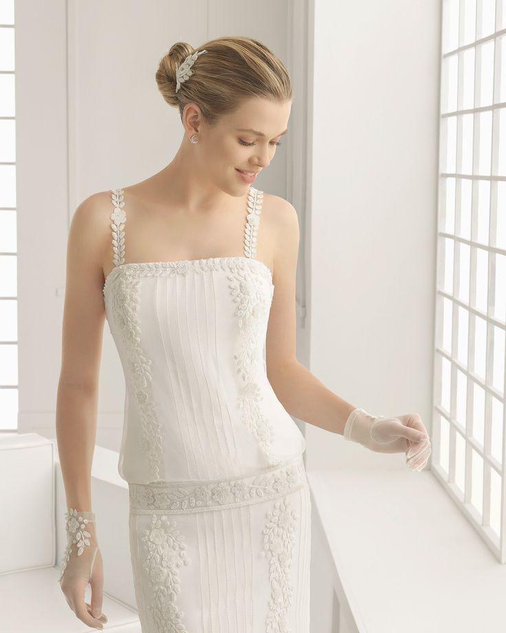 DONCELLA vestido de novia en tul plumeti con bordado pedrería y georgette con adorno de vainica.