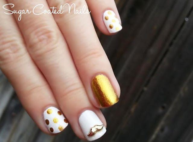 Witte nagels met 1tje gouden stippen