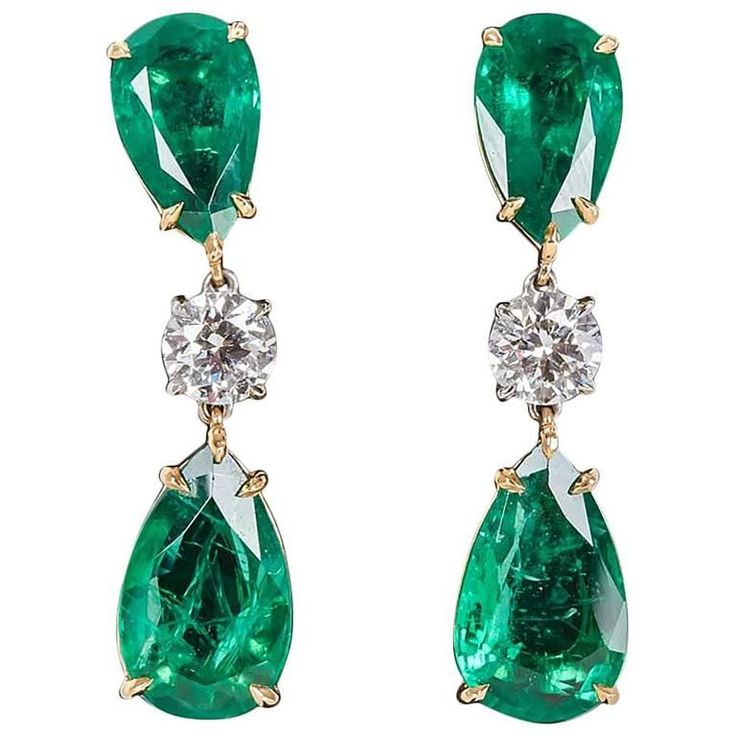 Elegant Green Emerald Diamond Gold Drop Earrings | 4 pear shape Green Emeralds with fine color and brilliance weigh 13.22. 2 round brilliant cut white diamonds weigh 1.67 cts. 18k yellow and white gold.