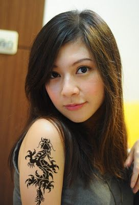 This is an example of dragon tattoos for women. You can find more dragon tattoos in here