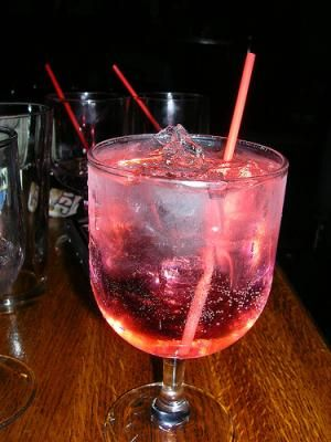 Jolly Rancher  Midorie, Cocunut rum, peach schnapps, pineapple cranberry juice and sprite