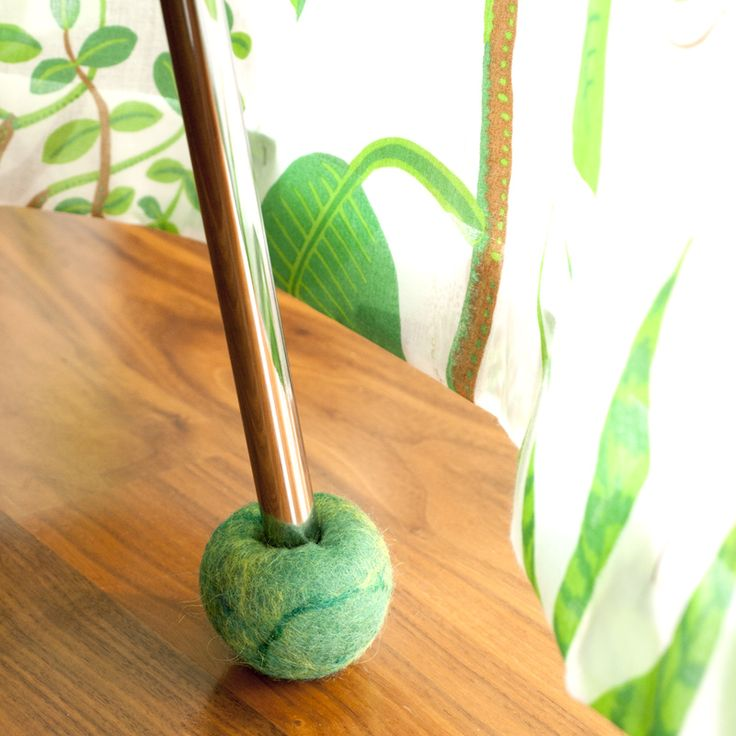 Felted green floor protector with an inner core of rubber