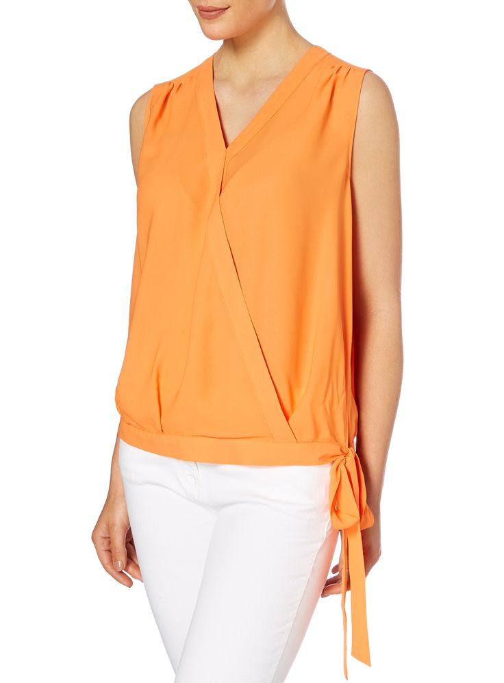 """Pack a powerful punch in a bold, bright chiffon blouse. With pretty shoulder gathering, side bow and a flattering wrap-over design, it's just brilliant for bigger busts."" - Gok</p><ul><li>Gok orange tie-waist wrap blouse</li><li>Sleeveless</li><li>V-neckline</li><li>Side-tie</li><li>Model's height is 5'11""</li><li>Model wears a size 12</li></ul>"