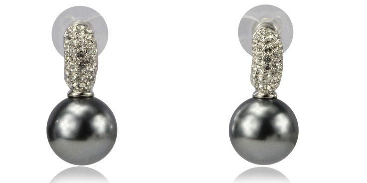 The Jessica dark pearl earrings with studded accents features classic shapes and a sleek color combination of silver and grey. This piece by Transfashions is composed of a dark pearl suspended from an accent piece studded by sparkly stones. The understated design makes this accessory versatile, it can perfectly contrast bold and dramatic ensembles or complement classy and elegantly restrained outfits.