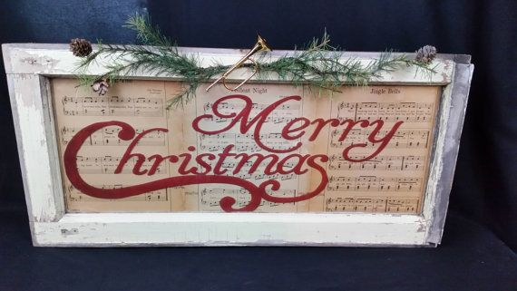 Vintage old window single pane window sash. Measures 29W X 14H X 1.5-2 D Decal on front reads Merry Christmas. Backed with antique sheet music
