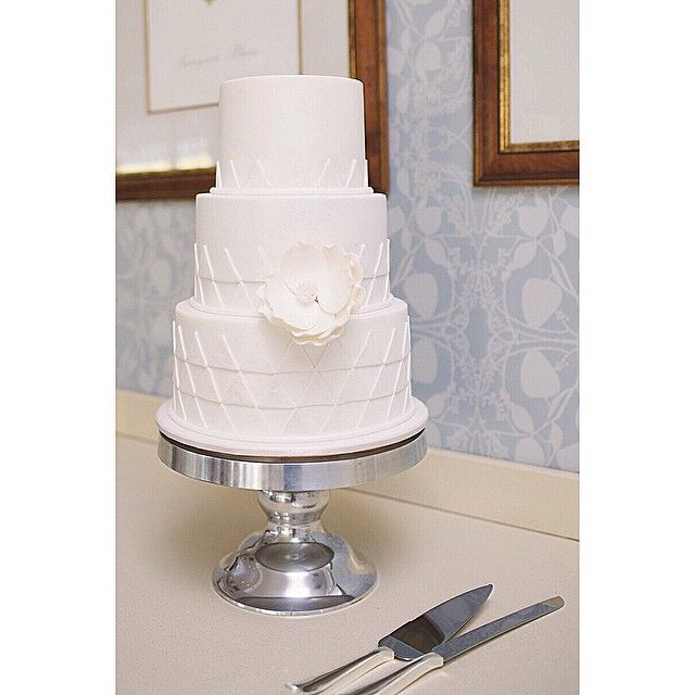 Triangle white on white cake by: @projectcake / PC: @impactimages